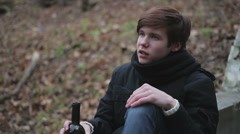 Hopeless young man drinking alcohol, has no faith in future, severe depression Stock Footage
