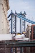 East River Bridge and urban buildings Stock Photos