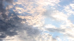 Cloud Layers Overhead at Golden Hour Stock Footage