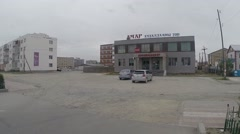 Several High-Rise Buildings About Which Parked Car in Mongolian City Stock Footage