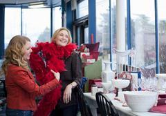 Women shopping in thrift store - stock photo