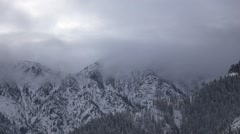 Rolling Fog Through the Snowy Alpine Mountains Stock Footage
