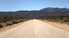 Staring Down a Stretch of Desert Highway Stock Footage