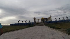 Approach With People by Way to Monumental Complex of Mongolian in Steppes Stock Footage
