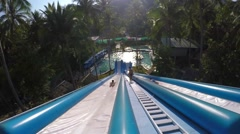 Tourists Having Fun on Water Slide in Tropical Aqua Park Stock Footage