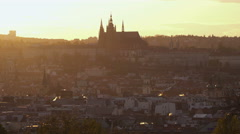 A view of the Castle in Prague during a sunset from the Reigrovy Sady. Stock Footage