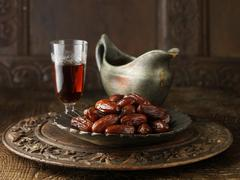 Speciality gravy containing dates and sherry on carved circular board with gray - stock photo
