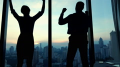 Successful business people raising arms in th office, power symbol, slow motion Stock Footage