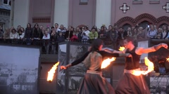 Exciting fire show with young artists dancers juggle burning torches. 4K Stock Footage