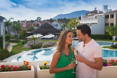Young couple at holiday resort with champagne Stock Photos