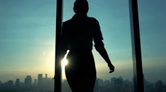 Young woman admire cityscape during sunset, slow motion Stock Footage