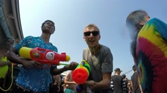 Man with Water Gun Shooting People at Songkran Festival in Hustle Crowd Stock Footage