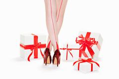 Woman wearing red stilettos with gift boxes Stock Photos