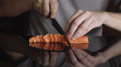 Professional chef cutting smoked salmon prepare for japanese sushi rolls Stock Footage