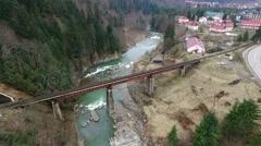 Beautiful landscape of bridge over mountain river Stock Footage
