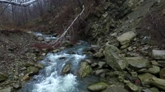 Mountain stream flowing over cliffs Stock Footage