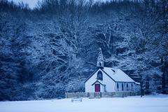 Isolated chapel in snow, St Georges Church, West End Village, nr. Esher, Surrey, Stock Photos