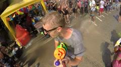 Cheerful Man Shooter with Water Gun at Street Celebrate Songkran. Slow Motion. Stock Footage