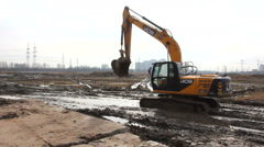 Excavator working on the construction at the stage of Foundation. - stock footage