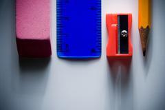 Eraser, ruler, pencil sharpener and pencil - stock photo