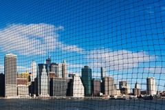View of Manhattan skyline through netting, New York City, USA Stock Photos