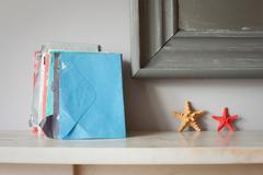 Envelopes and starfish on mantelpiece Stock Photos