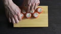Food, sushi rolls: Male hands preparing sushi set Stock Footage
