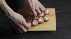Food, sushi rolls: Male hands preparing sushi set Stock Footage