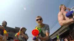 Crazy Man Shooter Celebrates Songkran on Street Party and Water Fights. Stock Footage