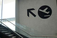 Arrow sign in airport Stock Photos