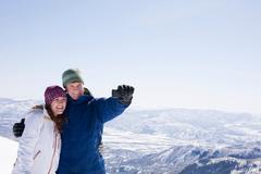 Young couple photographing selves, Brighton ski resort, Utah, USA Stock Photos