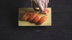 Food, sushi rolls: Chef put on a table sushi set. Top view Stock Footage