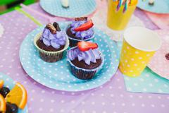 Cupcakes with the image of Alice in Wonderland - stock photo