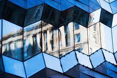 Office facade reflecting classical architecture Stock Photos