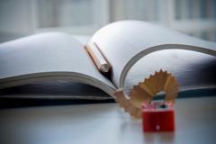 Notebook, pencil and pencil sharpener Stock Photos