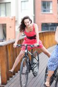 One young woman cycling - stock photo