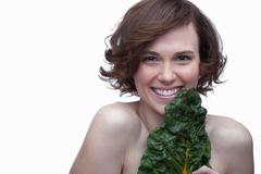 Young woman with chard Stock Photos