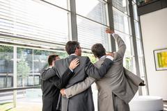 Three businessmen celebrating Stock Photos