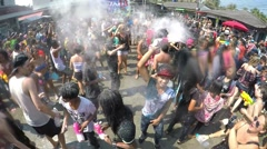 Crowd of Young People Celebrate Songkran Festival Dance with Talc Stock Footage