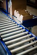 Detail of stationary conveyer belt in distribution warehouse - stock photo
