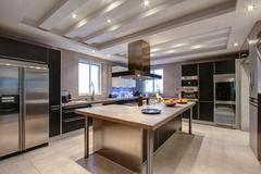 Luxury kitchen in wealthy home Stock Photos
