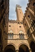 Architectural detail of Torre del Mangia, Siena, Italy Stock Photos