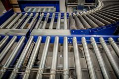 Empty conveyer belt in distribution warehouse Stock Photos