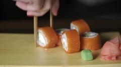Food, sushi rolls: Someone eats sushi rolls. Close up Stock Footage