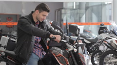 Consultant sitting on motorcycle Stock Footage