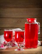 Jug and glasses with strawberry juice - stock photo