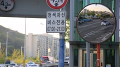 City traffic seen through a roadside mirror in Seoul Stock Footage