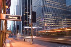 Illuminated subway sign at dusk, New York City, USA - stock photo