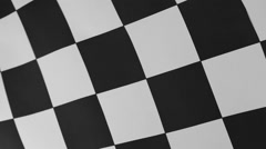 Closeup of black and white checkered flag - stock footage