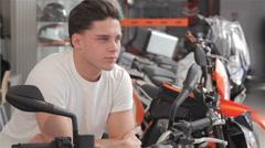 Buyer dreams on motorbike Stock Footage